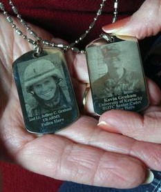 Carol Graham shares the I.D. tags memorializing her sons Jeff, left, and Kevin. (Photo by Helen H. Richardson, Denver Post)